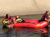Sacramento Metro Fire personnel rescuing doe from canal